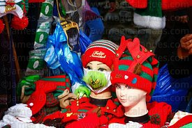 Detail of stall selling face masks (including one with The Grinch on it) and hats in a Christmas market, La Paz, Bolivia