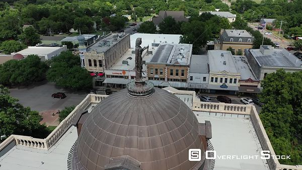 Statue on the dome and downtown buidings, Georgetown, Texas, USA