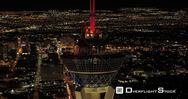 Las Vegas Aerial v35 Closeup shot panning around Stratosphere tower at night with panoramic views 4/17