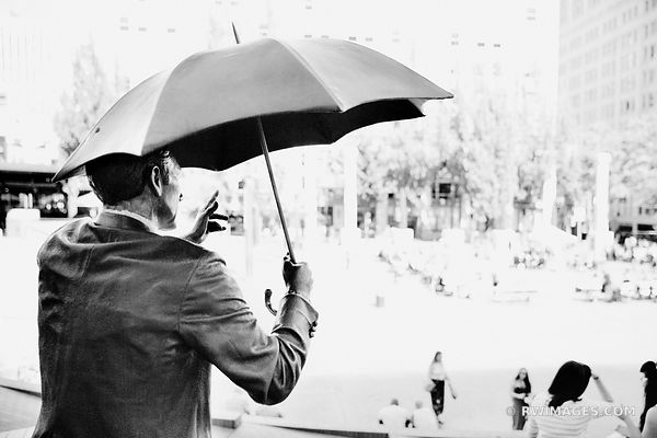 MAN WITH UMBRELLA SCULPTURE DOWNTOWN PORTLAND OREGON BLACK AND WHITE