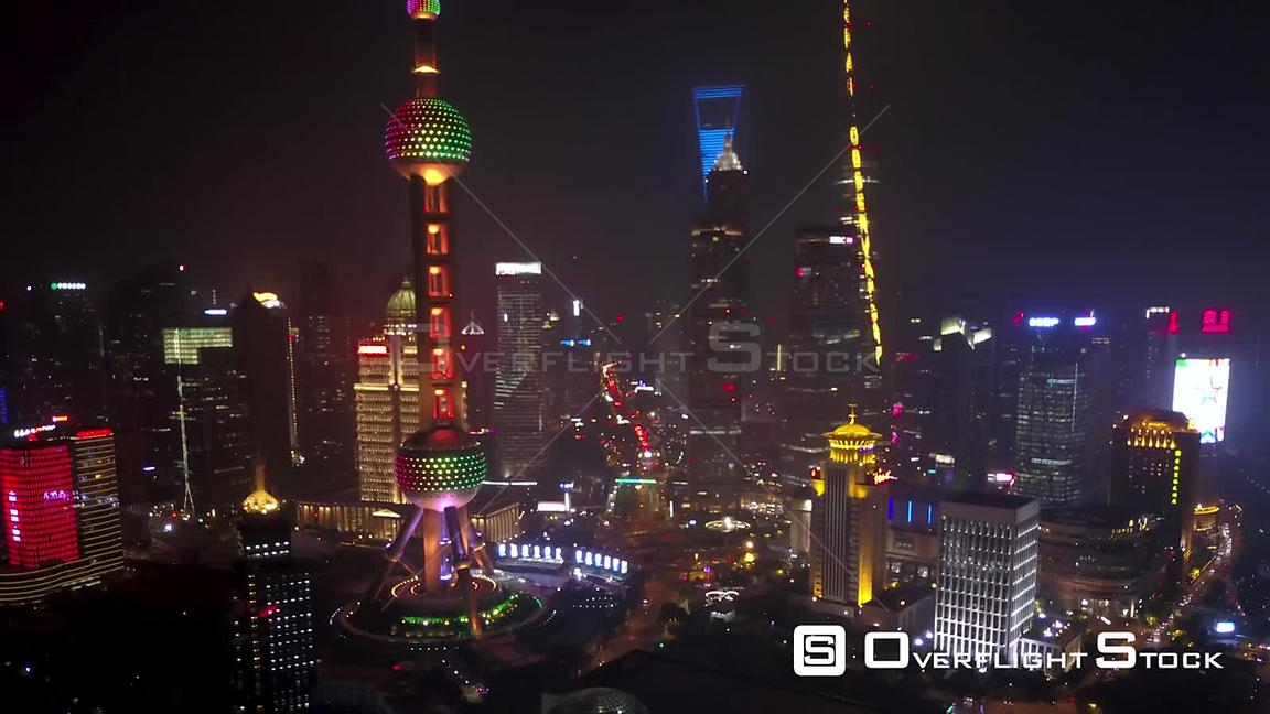 Shanghai  China Shanghai China Aerial Time Lapse Night  Flying birdseye view of busy financial district along river.
