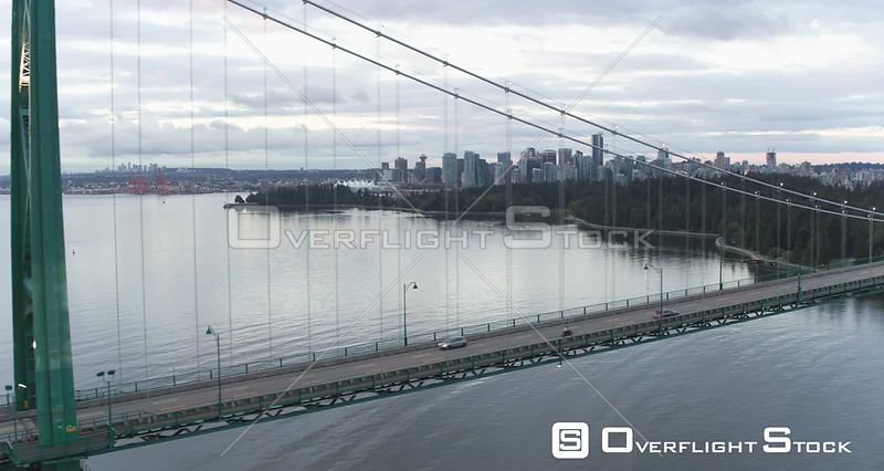 Lionsgate Bridge in Vancouver, BC, Canada. Cars and Bikes Driving Across Bridge Bay Inlet. Burrard Inlet, Stanley Park.