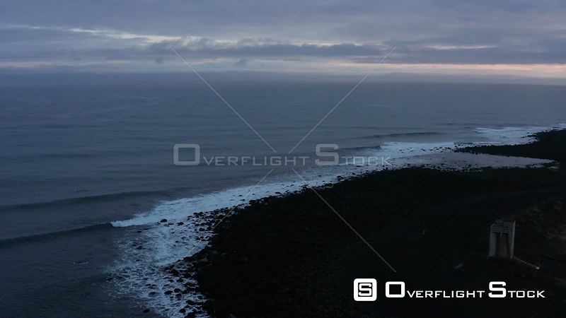 A Pan Over Around a Head Land Over Waves in Iceland.