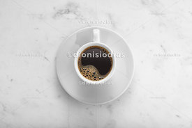 Full coffee cup on white marble background