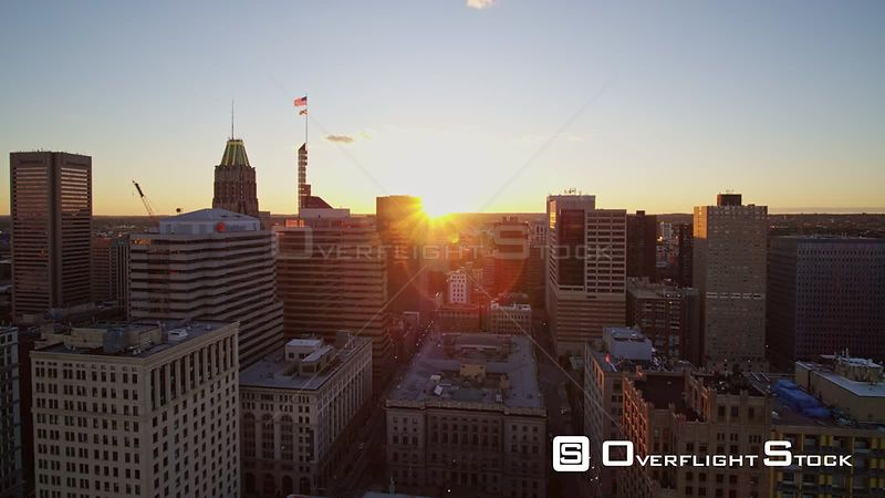 Baltimore Maryland Aerial Flying through downtown cityscape at sunset