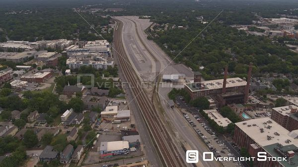 Atlanta Following path of train tracks near cotton mill lofts, low to high in reverse with multiple neighborhood views