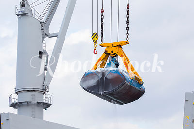 A Crane Lifts Bulk Material from a Freight Ship