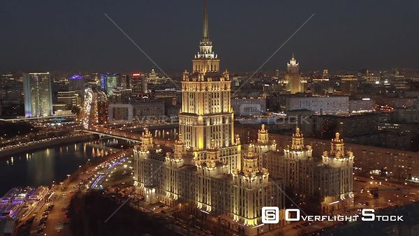 Dusk Flight Backwards from Moscow Historical Building, Radisson Sas Hotel and Spaghetti Junction With City Lights. Moscow Rus...