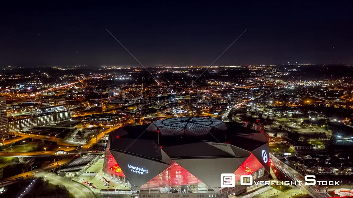 Atlanta Aerial Hyperlapse in reverse over city center with stadium view at night