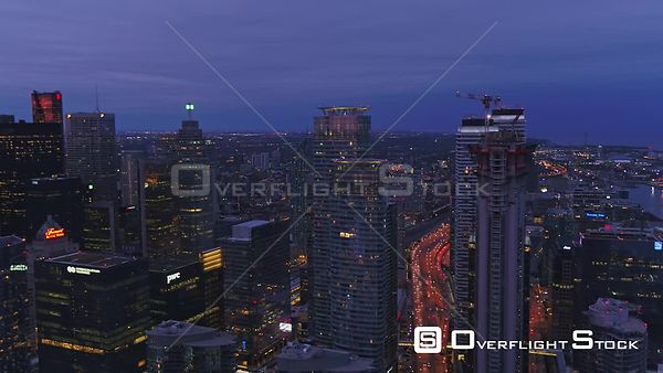 Toronto Ontario Ascending downtown cityscape panoramic at sunset with CN Tower in foreground