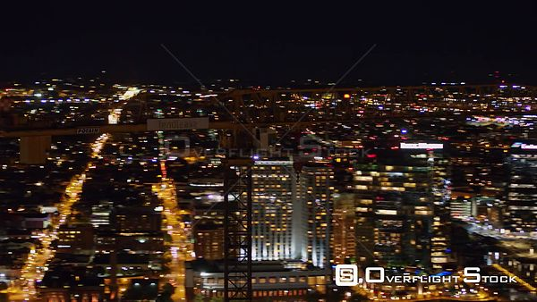 Baltimore Maryland Aerial Fast panoramic detail view of construction crane with nighttime cityscape in background