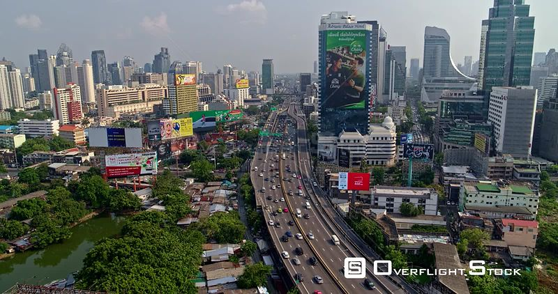 Thailand Bangkok Aerial Flying low along expressway with neighborhood detail