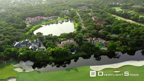 Aerial video golf course community mansion homes Jupiter Florida USA