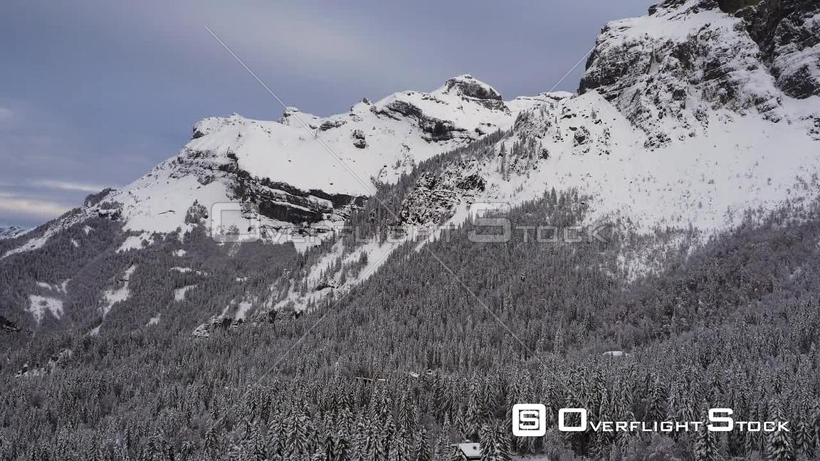 Snow covered mountains with trees in picturesque winter scene Chamonix, France