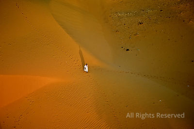 Lone Person on a Sand Dune Sahara Desert Chinguetti Mauritania Africa