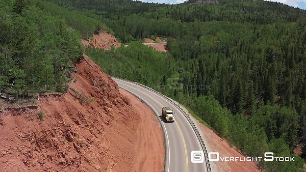 Curving Mountain Highway and trees, Teller County, Colorado, USA