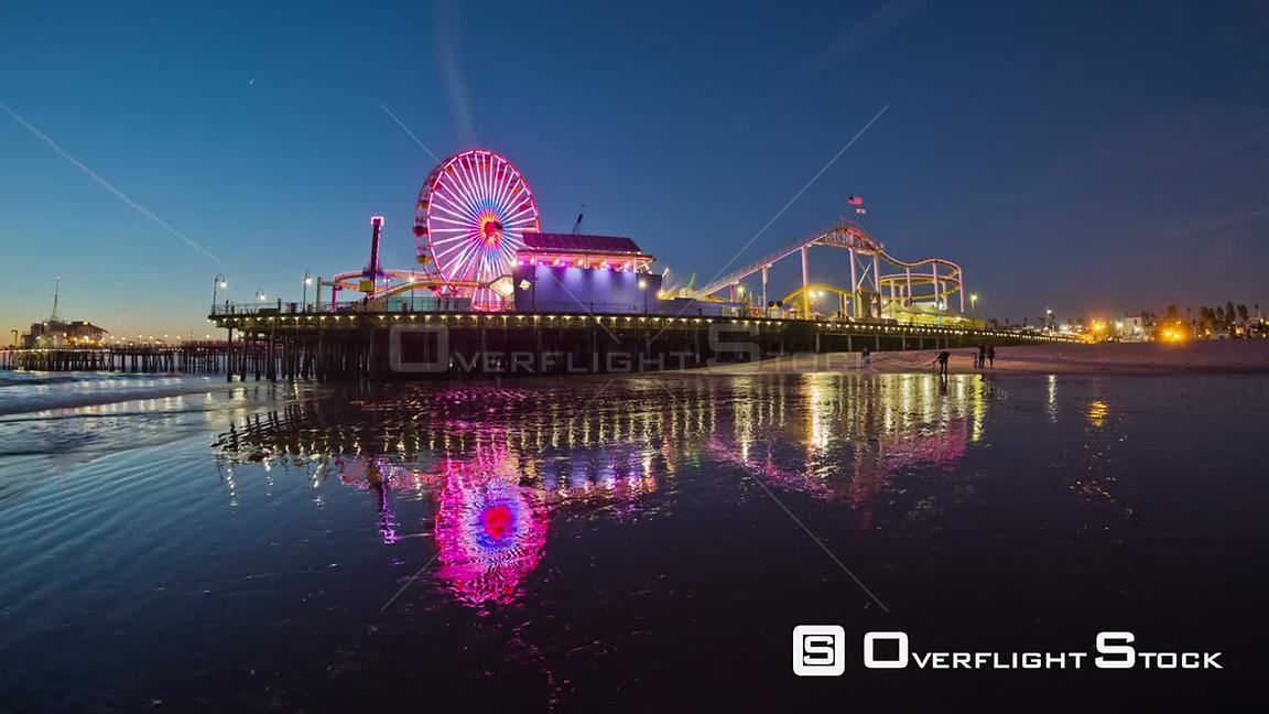 Los Angeles California USA Santa Monica Pier panning time lapse at dusk