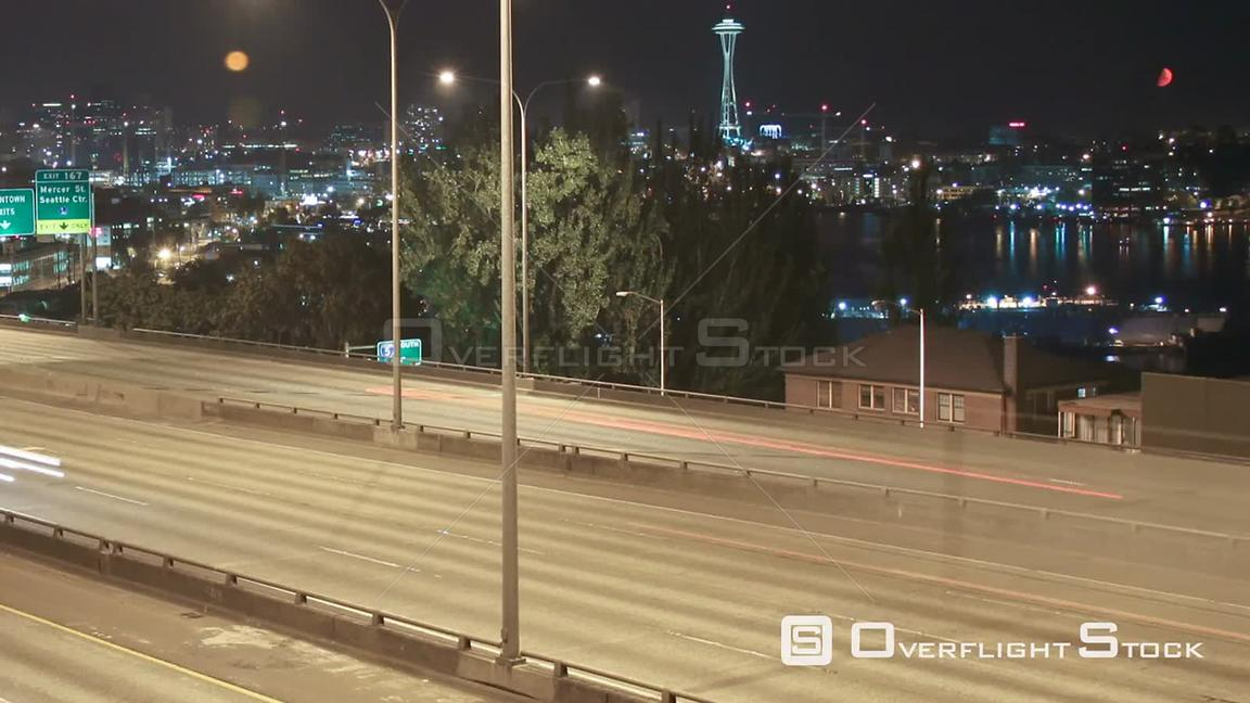 Seattle Washington State USA Panning time lapse of I5 freeway with Space Needle and cityscape in the background.