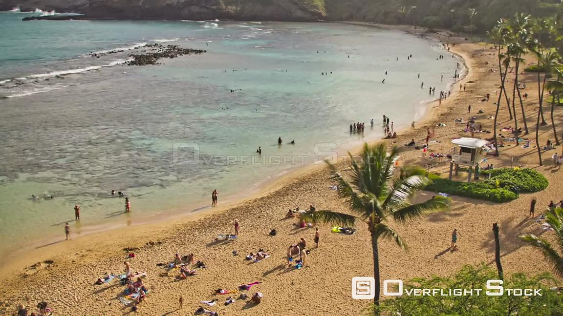 Hanauma Bay Beach Park time lapse clip with fish swimming close by, people snorkeling and on beach, and Koko Head Crater in b...