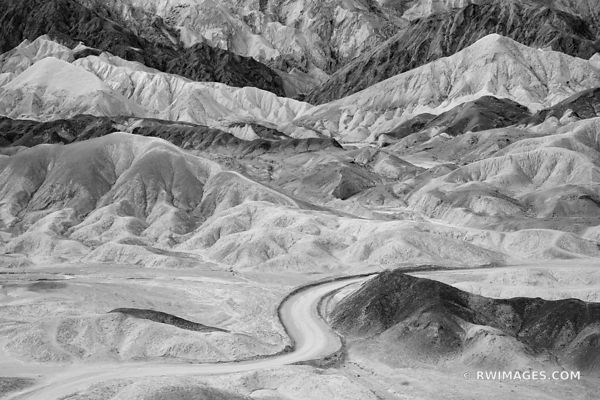 DESERT ROAD THROUGH BADLANDS TWENTY MULE TEAM CANYON DEATH VALLEY CALIFORNIA AMERICAN SOUTHWEST BLACK AND WHITE DESERT LANDSCAPE