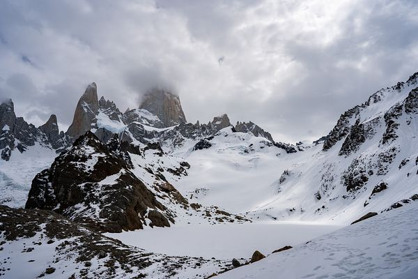 Low cloud over snowy mountain peak, Mount Fitz Roy, Cerro Chalten, Argentina, Patagonia, South America. Photo by Jason Tinacci