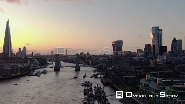 City of London Skyline, The Shard and Tower Bridge, filmed by drone in autumn, at sunset London, United Kingdom