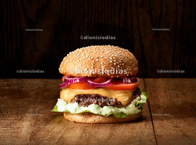 Traditional Cheeseburgers on wooden background.