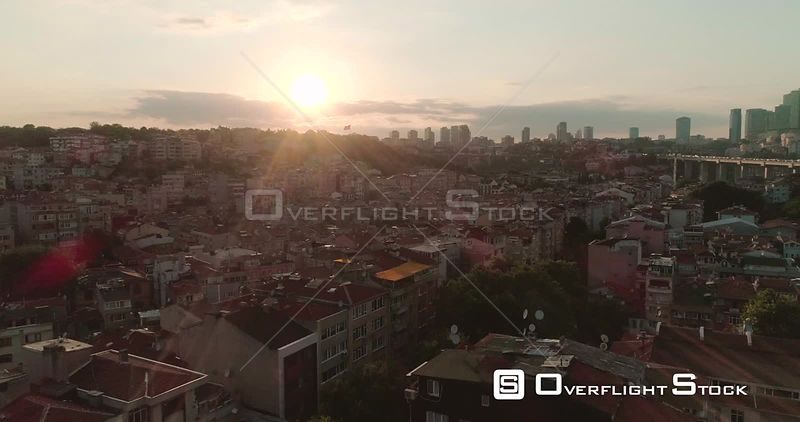 Aerial View of Istanbul Neighbourhood Rooftops Next to Bosphorus Bridge, Otrakoy Into Sunset Turkey