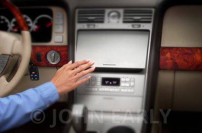 Women's Hand Reaching For Center Console in Vehicle