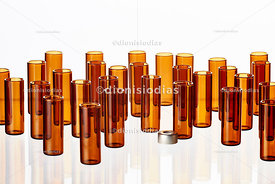 Group of amber vials on white background.
