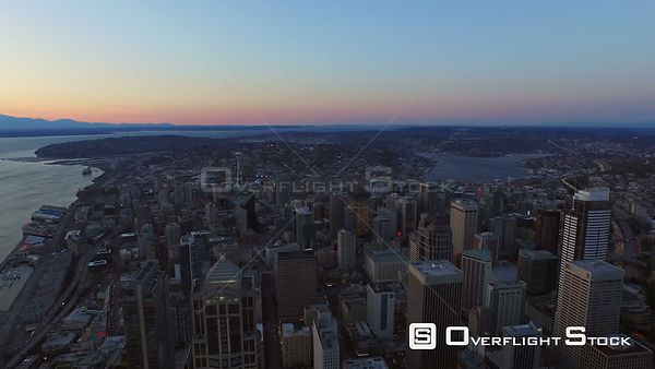 Seattle Washington State USA Flying over city center downtown at dusk