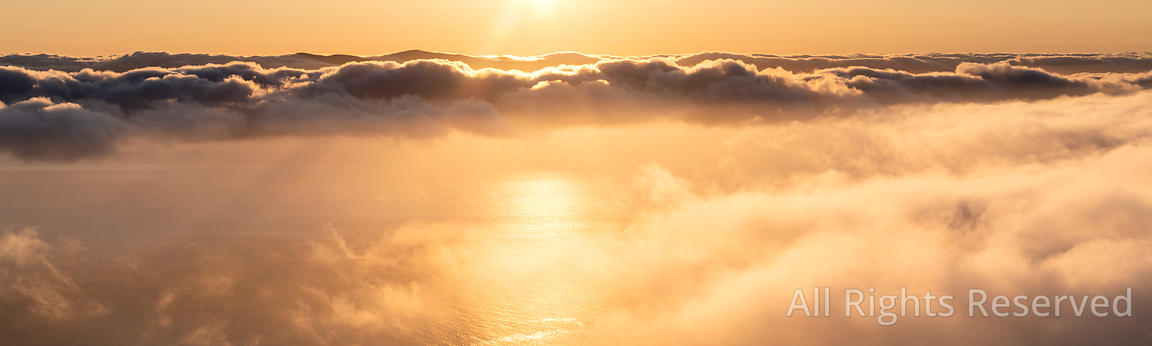 Aerial View of an Orange Sunrise Sunset Over a Cloud Layer the Pico - Sao Jorge Channel, the Piece of Atlantic Ocean in Betwe...