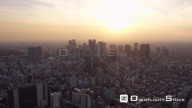 Japan Tokyo Aerial Flying low over Shinjuku area panning cityscape views dusk