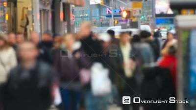 Time lapse of anonymous large crowds walking by in city & crossing streets. New York City