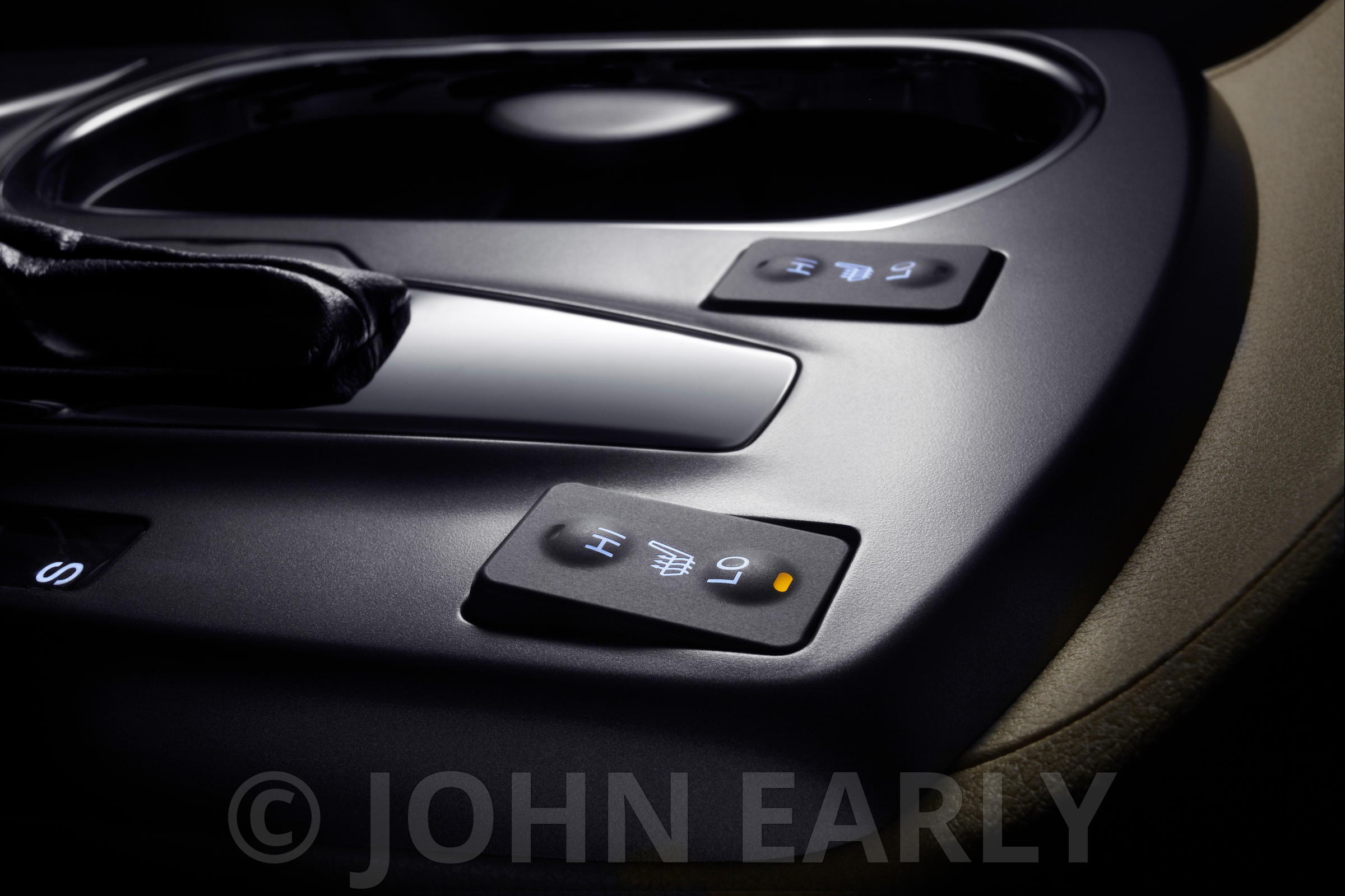 Moody Close-up of Seat Heater Buttons in Vehicle