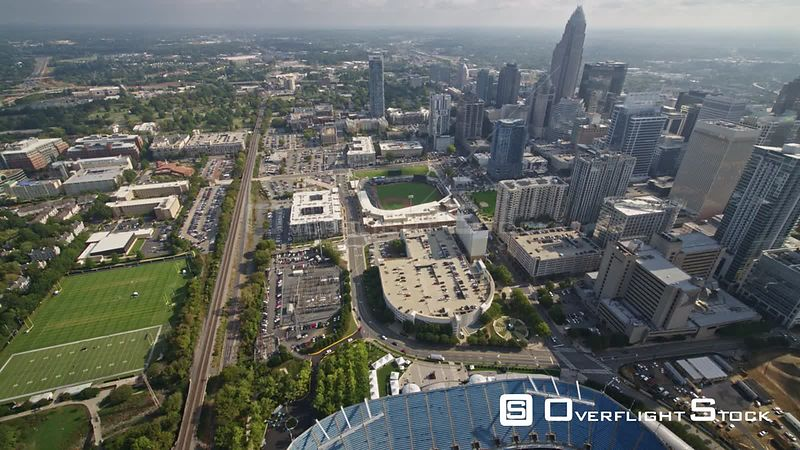 North Carolina Charlotte Aerial Birdseye view of downtown flying over stadiums