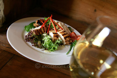 Grilled chicken salad and wine.