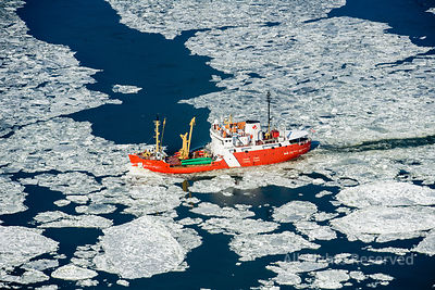 Canadian Coast Guard Vessel on Frozen St Lawrence River in Winter Quebec Canada