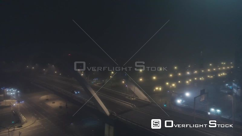 Night time tracking shot of a black car on a bridge in Buhcarest, Romania
