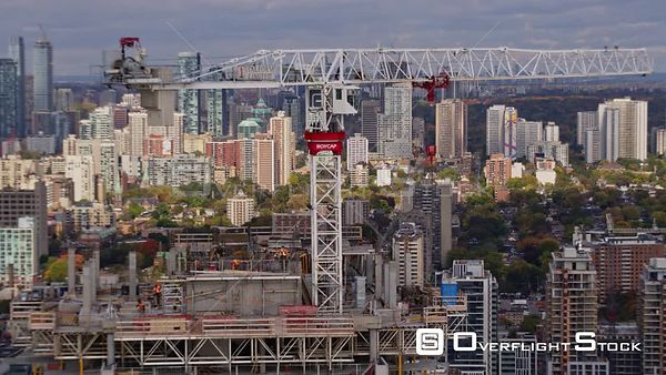 Toronto Ontario Very close up panoramic view of high rise construction with scenic downtown skyline in backdrop to start