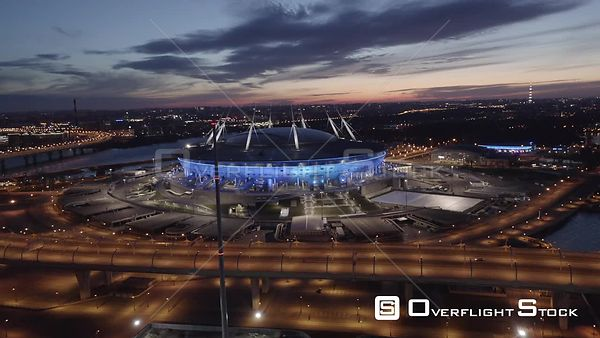 Fly Backwards from Zenit Arena Stadium at Sunrise. Saint Petersburg Russia Drone Video View