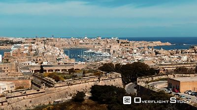 Aerial descending view of the towns of Vittoriosa and Valletta and the entrance of the Grand Harbour in Malta