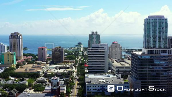 Aerial video St Petersburg Pier visible through downtown 4k