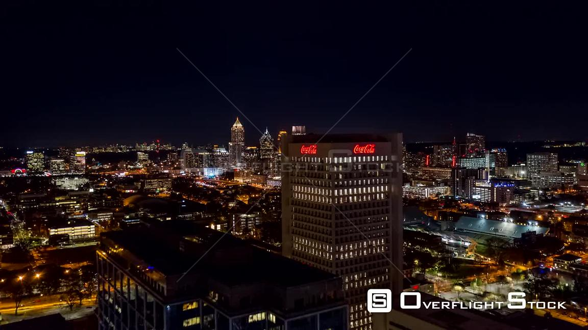 Atlanta Aerial Hyperlapse flying toward downtown cityscape with dense freeway traffic at night