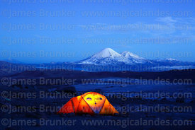 Base camp for Guallatiri volcano in pre dawn twilight, Payachatas volcanos in distance, Lauca National Park, Region XV, Chile