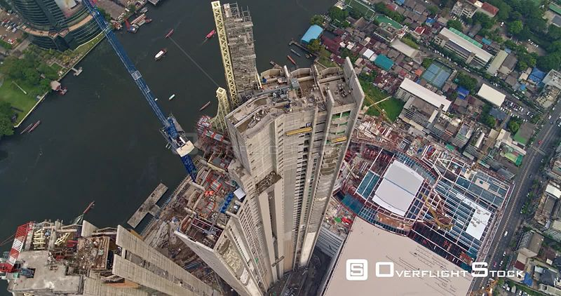 Thailand Bangkok Aerial Vertical to birdseye detail view of riverfront building construction