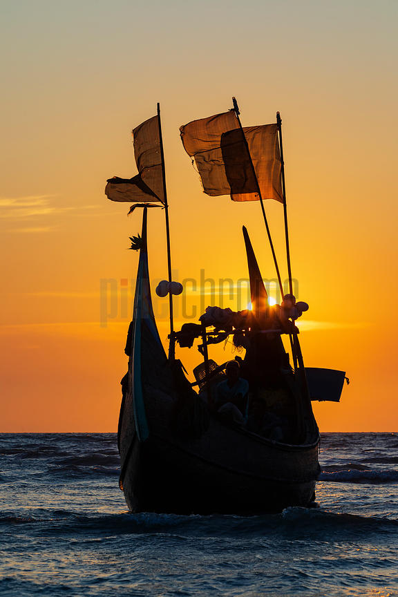 A Traditional Crescent Boat on Inani Beach towards Sunset
