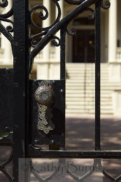 New Orleans antique doorknob on an iron gate