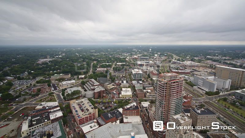 North Carolina Durham Aerial Panning birdseye view of city center construction