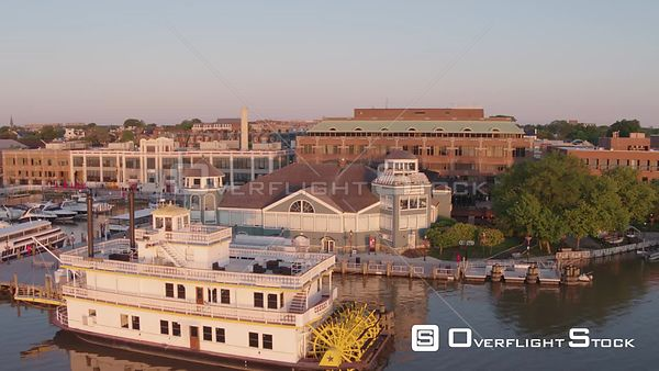 Rising from the Cherry Blossom steamboat and the Chart House at the Old Town Harbor to show the Alexandria skyline and masoni...